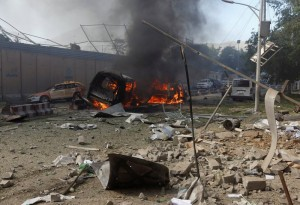 Burned vehicles are seen after a blast at the site of the incident in Kabul, Afghanistan